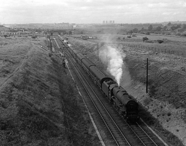 Jubilee on diverted express, taken from Tame Valley Viaduct, looking towards Bescot 1958